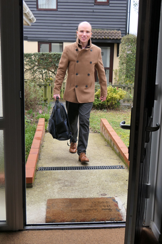 Photo of Marc Fowler walking into a home